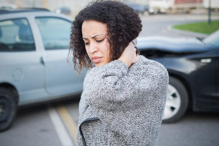 Woman experiences Whiplash and neck pain after an accident.