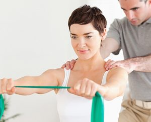 female patient performing an exercise with a physiotherapist