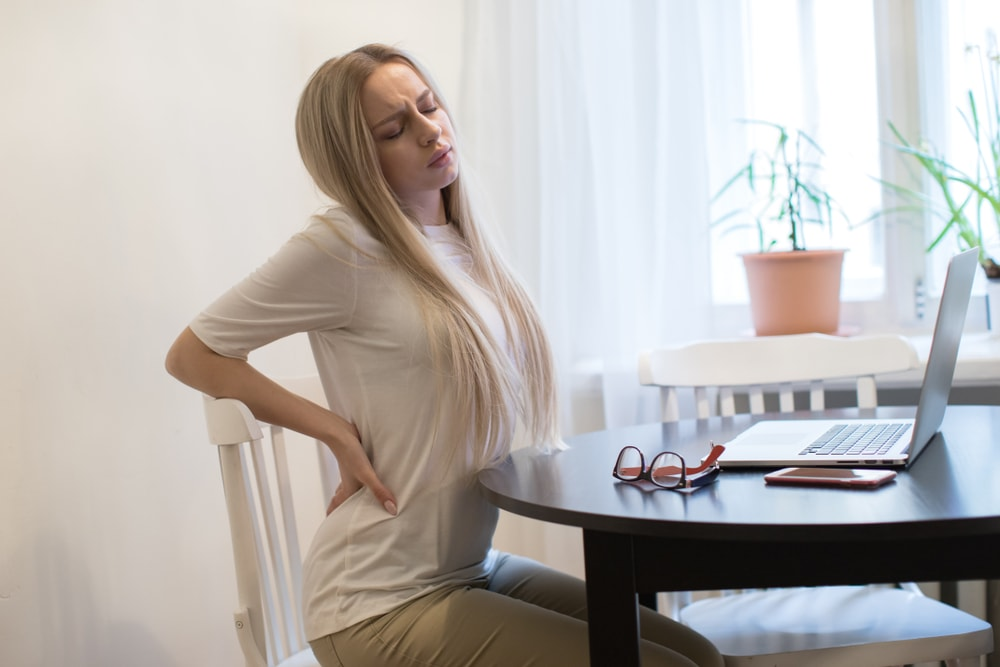Woman Experiences a Pinched Nerve Chiropractor South Florida