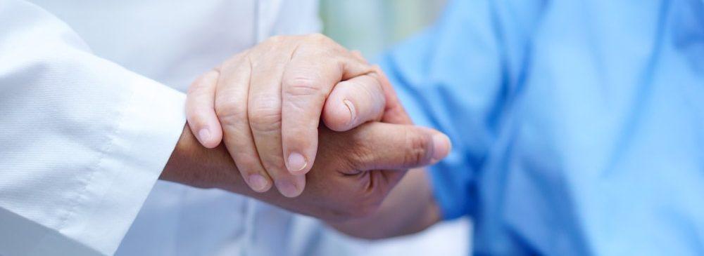 Chiropractor shaking hands