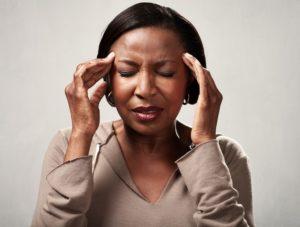 Symptom of Personal Injury Headache is felt by woman