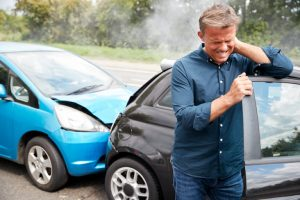 man holding his neck due too auto accident