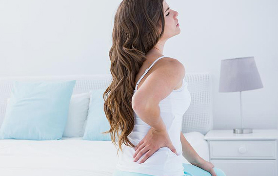 patient with back pain using spinal decompression treatment at back to mind chiropractic