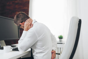 office worker experiencing neck pain