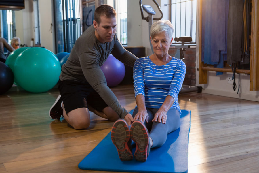 physiotherapist showing patient a workout
